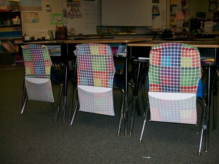 Use stretchable book covers as chair pockets.  You can stock up during back-to-school sales!