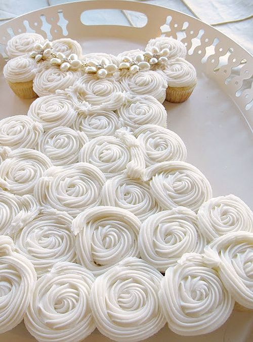 Clever Wedding Dress Cupcakes for your Bridal Shower! These cuties are Lemon Supreme Cupcakes with delicious icing roses on top! Made by Sharon over at Purple Chocolat Home ❤ http://www.purplechocolathome.com/2013/05/perfect-bridal-shower-cake.html ❤ Wedding Dress Cake ❤ Gown Cake ❤ Bridal Shower Cake ❤ Cupcakes ❤