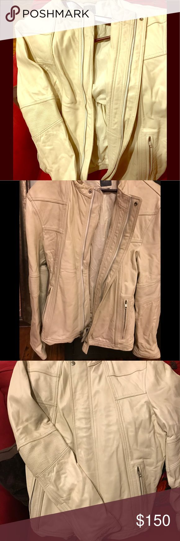 White Armani Leather Moto Jacket XL men's/women's Check out this super stylish white XL Moto Jacket From Armani Exchange. The leather is so soft and the Jacket can be for men or women. Just need the right person to rock this look. There's a small black mark near collar but should be easily.cleaned. Can't wait to see the Jacket on one of my posh mark peeps. 150 or make an offer. A/X Armani Exchange Jackets & Coats Military & Field