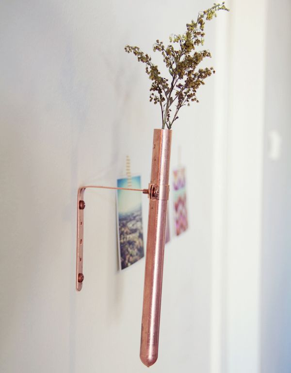 Copper Bud Vase. Maybe not this one specifically but it would be cute to have a hanging vase this small for a single flower or 2 to always have around. add a small touch of life to the home