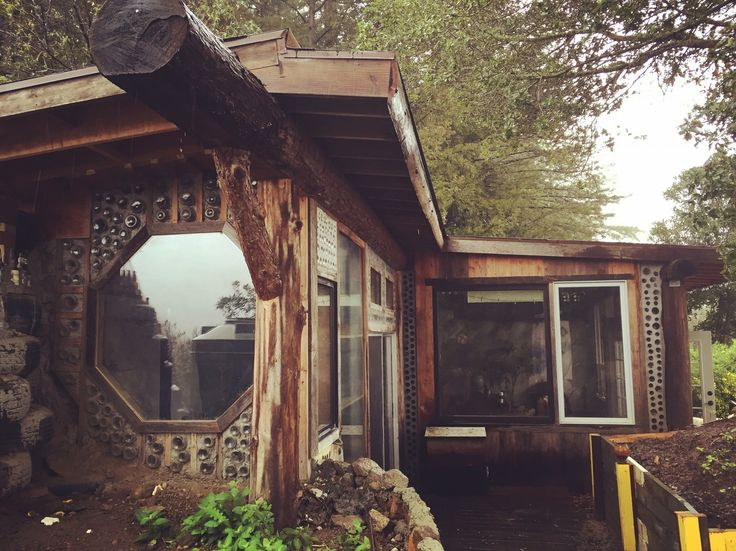 """Taylor & Steph's Small, Sustainable """"Earthship"""" Home in the Mountains - AKA crazy homeless people house where the people know how to use wood 'n shit"""