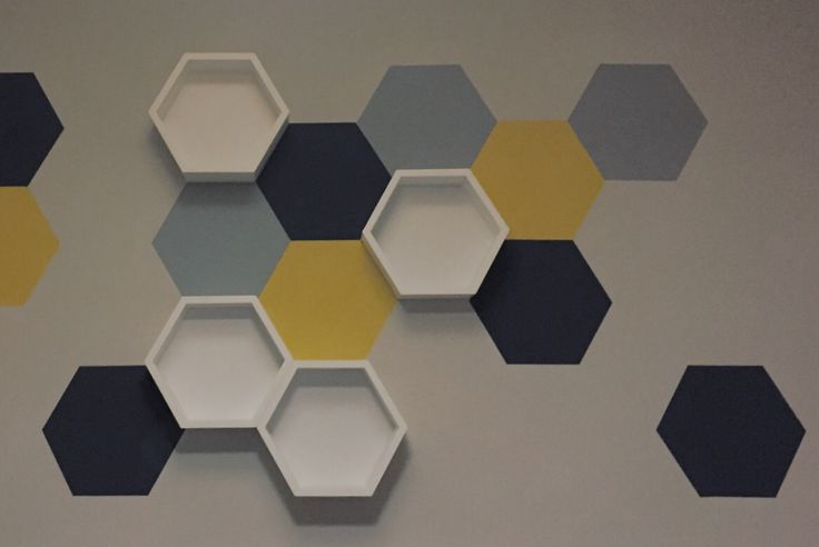 Painted hexagon wall art with shelves. #nursery #newbaby #wallart