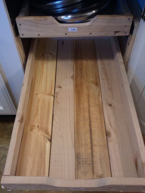 DIY drawers for the kitchen cabinets ... she makes it sound temptingly easy