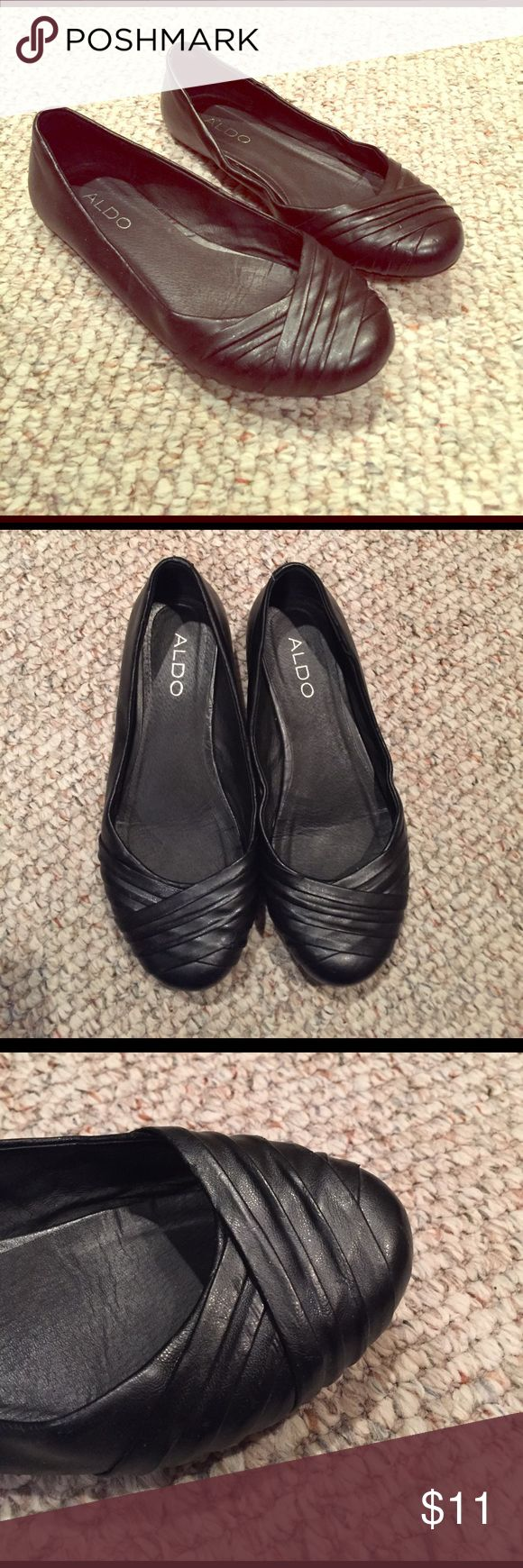 Aldo black leather flats Black leather flats with cross-crossing fabric across the toes from Aldo. These have been worn a bit- take a look at the soles. The tops of the shoes are still in great condition and they are very comfortable to wear. They don't hurt your toes or rub your heels the wrong way when wearing them. Aldo Shoes Flats & Loafers