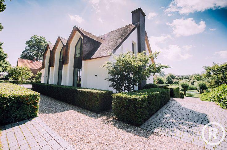 Tuininspiratie De Rooy Hoveniers klassieke tuin villa tuin voortuin taxushaag Waspik