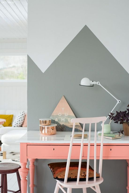 Half-painted wall and coral painted desk