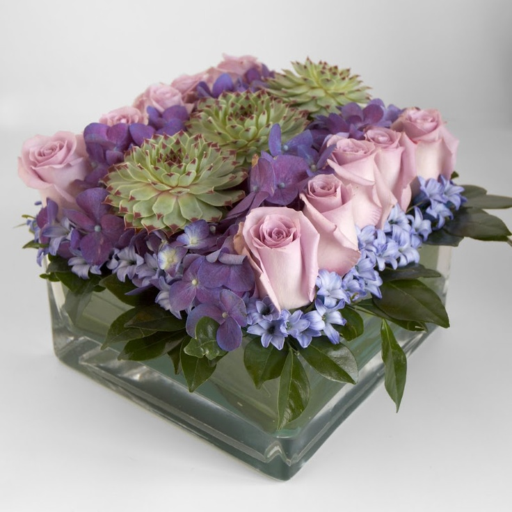 Charlotte Design ..... This is an example of a Pave flower design, it can be duplicated as a bridal bouquet. Flower varieties are sometimes grouped together for more visual and color impact.