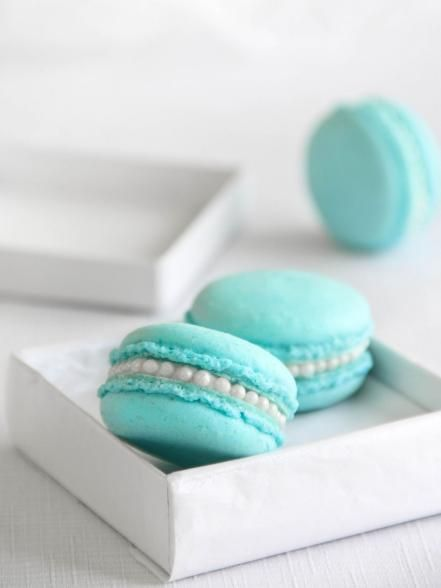 """You've got to have """"something blue"""" at your wedding. These delicate treats look just like jewelry when packed in little boxes. (Hello, pearl dragees!) Get the recipe."""