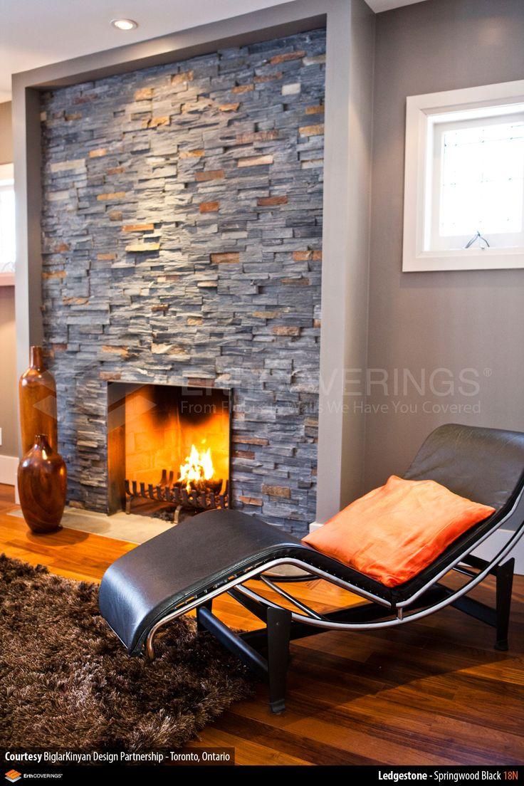 Living room fireplace clad in ErthCOVERINGS Springwood Black Ledgestone  Series natural stone veneer