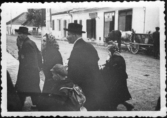 Bratislava, Slovakia, Jews with their belongings during deportation. Take what you can carry. Placed in a overcrowded ghetto, deported to death camp and gassed. Their life end has started and they yet know it. So terribly sad