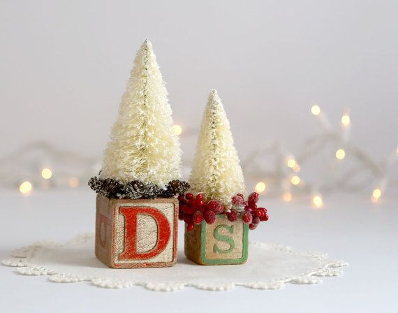 Ive created two vintage alphabet blocks for Christmas decor. I topped them off with bottle brush trees which I bleached and glittered myself.