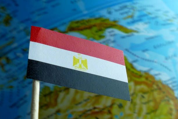 egyptian flag with a globe map as a background macro