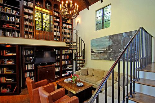 Country House media room and library. Bottom left hand corner of the picture a hidden room behind the book shelf. Two story book shelves, just love.