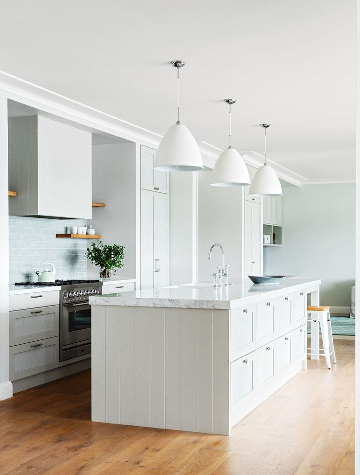In the kitchen are Gubi 'BL9 Bestlite' pendants in matte white from [Cult