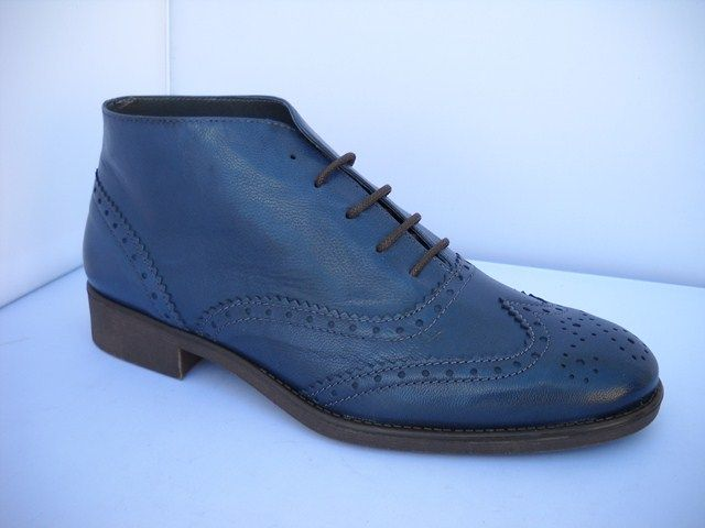 1 Bertuchi 2058 - B -  Bertuchi from Spain.  Europe's fine styling ankle boot with perforated lace trim design available in Monaco Blue and Bosque Green.   Sizes range 37-41.