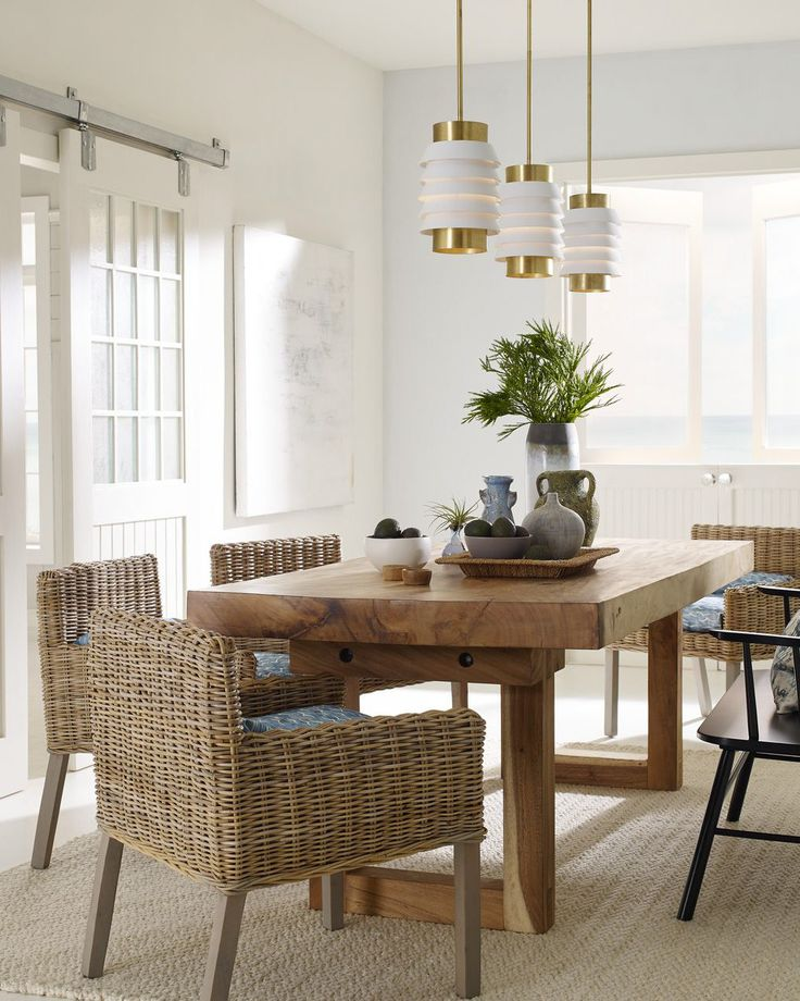 This coastal dining room features the designer Onshore ...