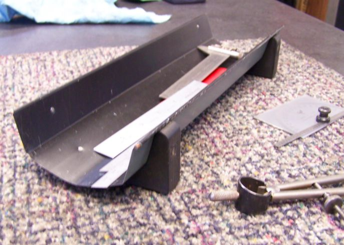"""Scale Holder by Toolmaker51 -- Our variety of holders is widespread! A reference to using a cutlery tray initiated an add-in.  Working everyday as a Toolmaker and Inspector; I use scales continuously, irritated when they are 'hard' to pick up with short nails. Unable to find a single cavity commercial tray longer than 12"""" with a rounded bottom; it was time to fabricate.  I used roofing metal, it's about .015 thick. Wired edges close over welding filler rod. Formed radius over 4"""" tubing...."""