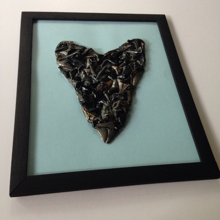 """Shark tooth art!!  Large """"megalodon"""" shark tooth made of shark teeth on light blue card stock paper in black frame!  Available for purchase at www.etsy.com/shop/TwoGirlsandaBoat"""