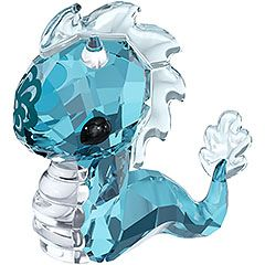 Zodiac - Tatsu the Dragon Known for being strong, dynamic, and energetic, this dragon can become your talisman. It shines in Indicolite crystal with a Light Azore crystal tail and scales, clear crystal details and a floral print.