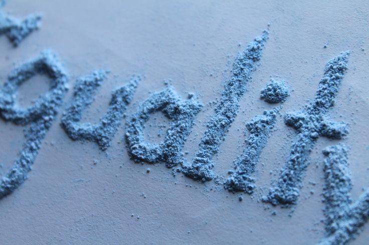 'Equality' blue chalk powder typography
