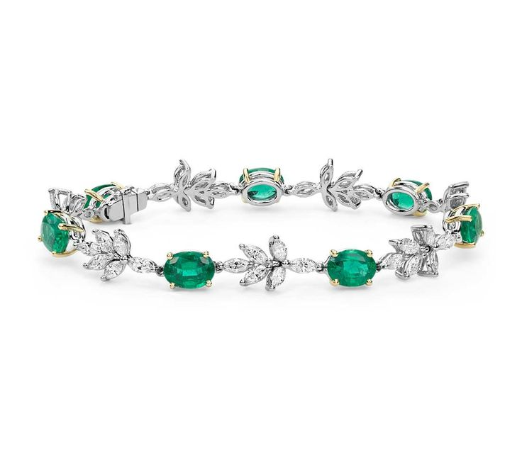 This dramatic gemstone bracelet showcases vibrant emeralds highlighted by sparkling marquise diamonds.