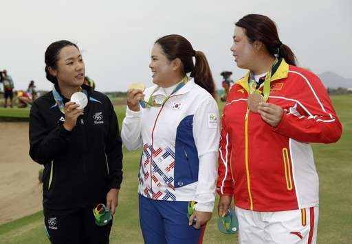 In China, a forgiving public embraces fewer gold medals:  August 21, 2016  -      From left to right, silver medalist, Lydia Ko of New Zealand, gold medalist Inbee Park of South Korea, and bronze medalist Shanshan Feng of China, show their medals after the final round of the women's golf event at the 2016 Summer Olympics in Rio de Janeiro, Brazil, Saturday, Aug. 20, 2016. (AP Photo/Alastair Grant)