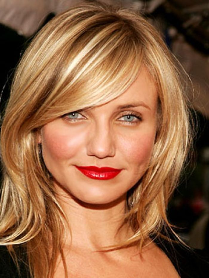 Really like this cut, long bangs and layers that fall around the collar bone and a bit below.