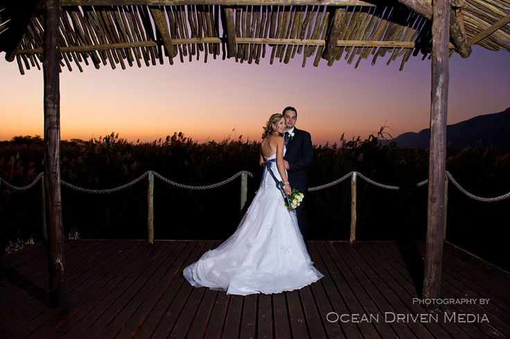 Bride and groom with stunning sunset