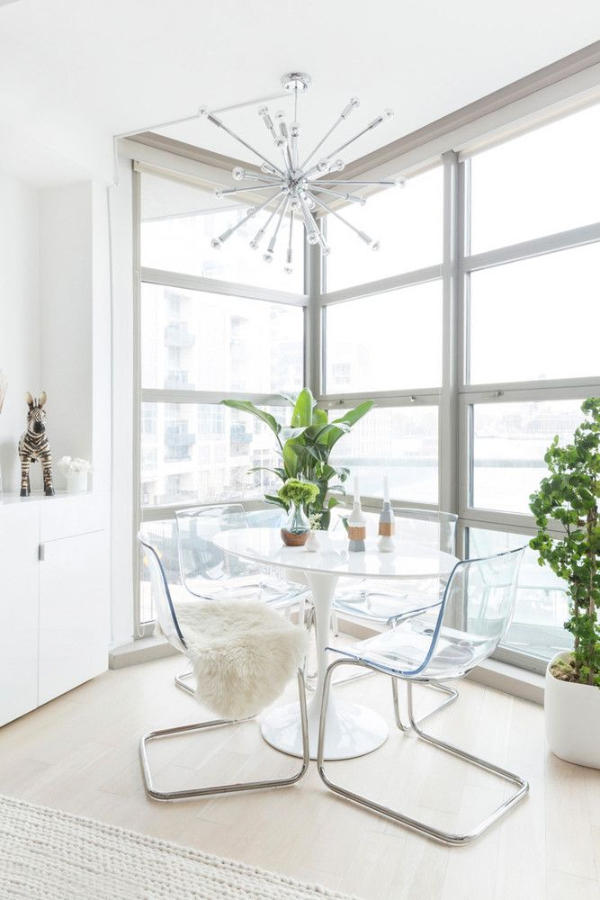tiny dining room with clear chairs and mod marble table