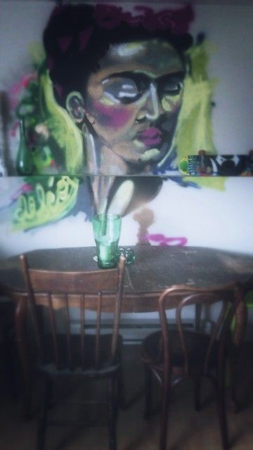Frida khalo graffiti-style painting/mural/portrait in my dining room