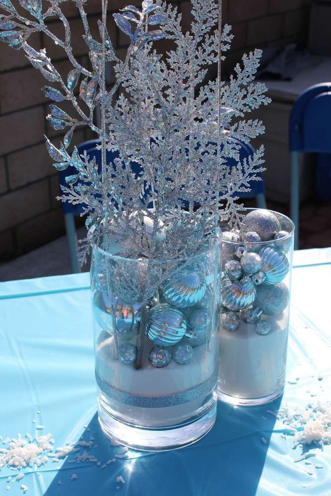 Lovely centerpieces at a Frozen birthday party! See more party planning ideas at CatchMyParty.com!