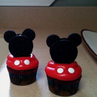"Homemade Mickey Mouse cupcakes ears are mini Oreos w/ cream removed from back.  Dip in chocolate and place between Double Stuffed Oreos to make face. Buttons are candy ""eyeballs"" turned upside-down (sold at ACMoore). Very easy!"