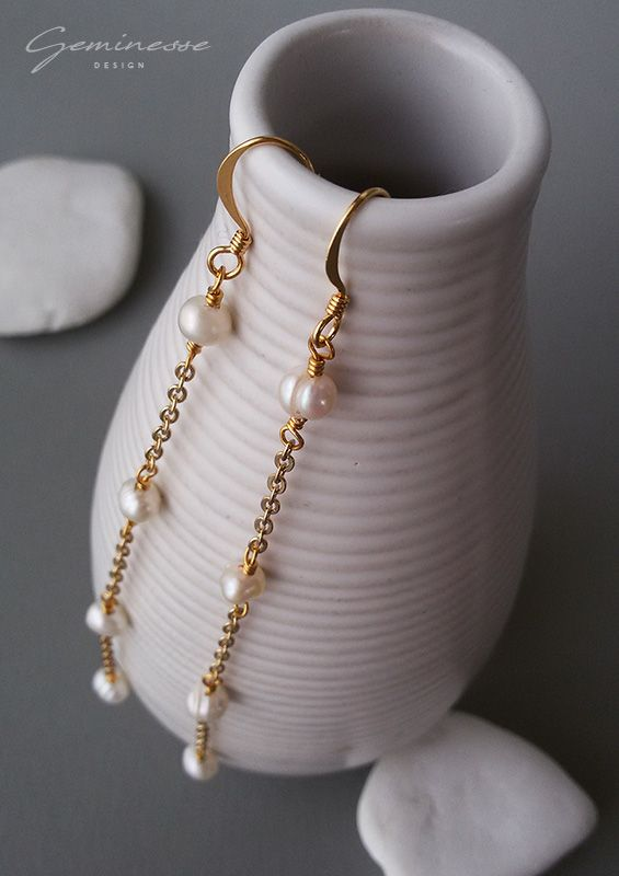 Gold plated long dangle earrings with freshwater pearls