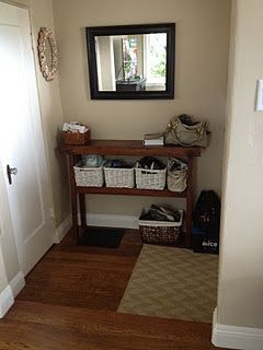 Great way to organize the entry in small house - small shelving unit, baskets and containers.  Make things convenient for your family to be organized and everyone benefits, reinforce with your children and they'll benefit as adults.  #organizing_for_tranquility