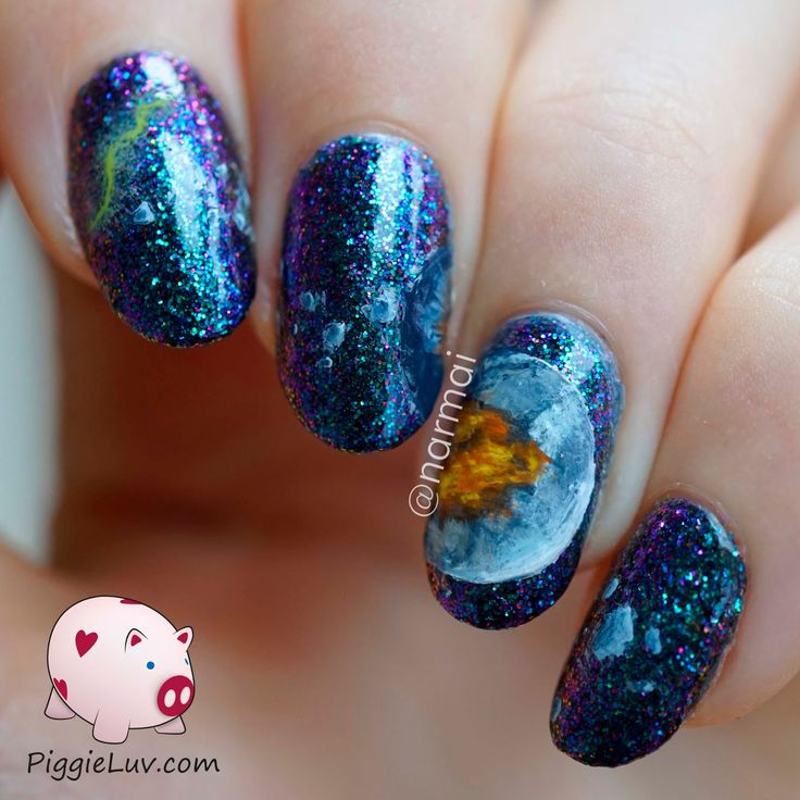 Today's nail art was supposed to be pretty different, and by different I mean better. it's supposed to be an exploding planet but it looks like a helmet :D The polish underneath is awesome though!! It's Digital Nails Serenity