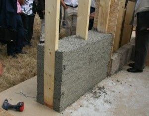 Hempcrete. It is made from the leftover stalks of hemp plants mixed with lime. This amazing product actually has a Negative carbon footprint since it continually draws co2 out of the air. It is lightweight and will not crack or mold.