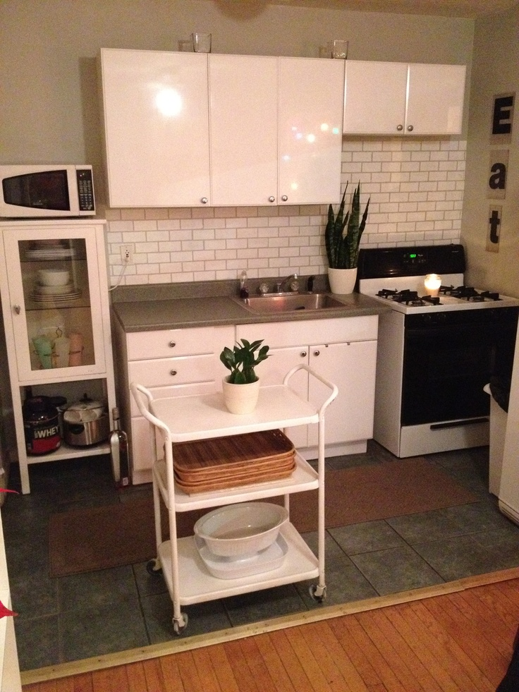 subway tile backsplash using a brick stencil and a can of