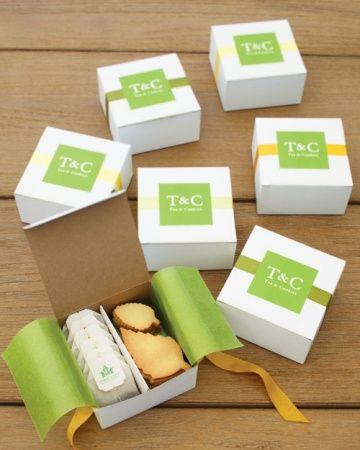 A Perfect Pairing-Tea and cookies were packed together in boxes lined with green glassine and sealed with a sticker bearing the couple's initials