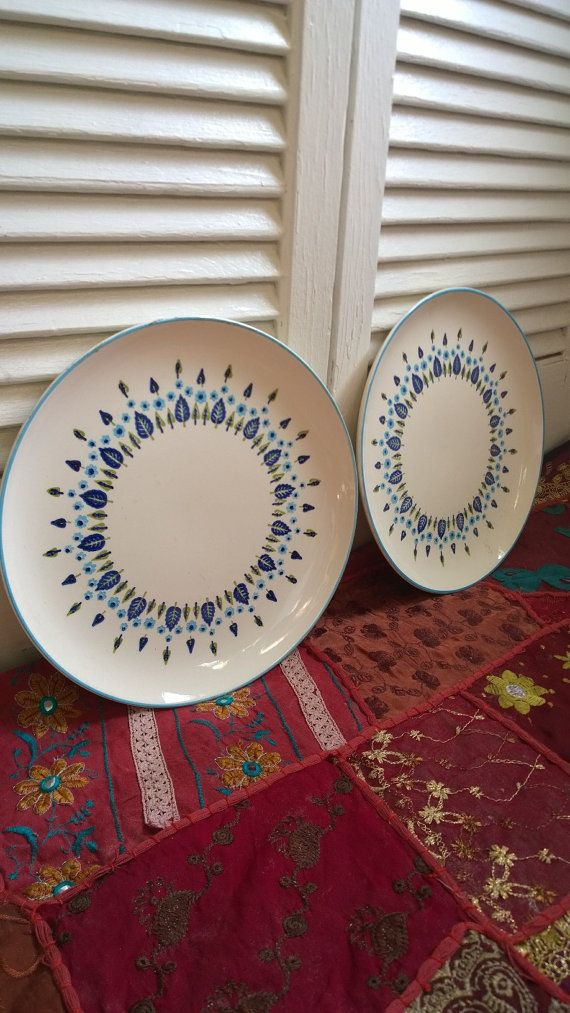 This set of two mid century modern dinner plates was made by Stetson Marcrest and is in the swiss alpine pattern. The two plates feature leaves,