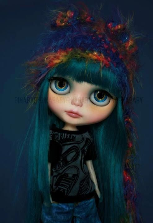 Blythe doll with cool blue/green hair