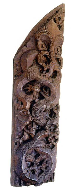 Marakihau-style carving. The figure at the top is a marakihau, sometimes described as a sea taniwha.