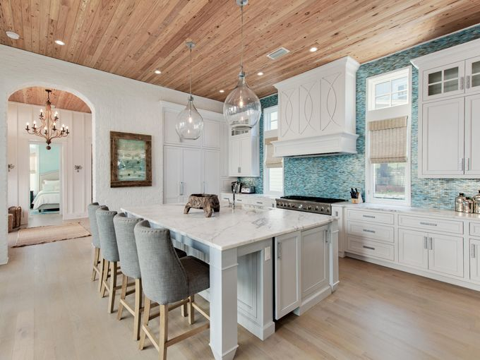 coastal kitchen with turquoise blue backsplash | Nest Interior Design