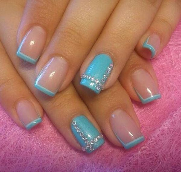 Aqua blue French tips. Add a bit of style to your French tips by adding a little edge on the side coupled with embellishments on top to add to the effect.