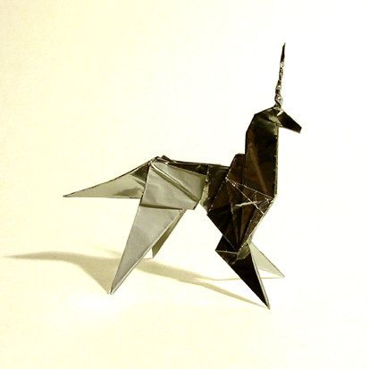 Replica prop of the origami unicorn from the film-noir sci-fi classic BLADE RUNNER. In the film, the mysterious character of Gaff(Edward James Olmos) leaves his trademark calling card of an origami(Japanese paper folding) figure at three points during the film directed toward Deckard(Harrison Ford). The last one, a unicorn, may be a significant clue as to the very nature of his character. DIMENSIONS: 4 (L) x 1-3/4 (W) x 4 (H) This is a 2:1 scale reproduction of the unicorn that is…