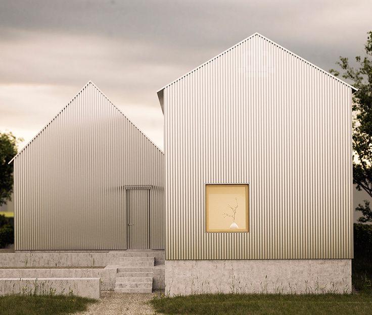 gabled aluminium home corrugated minimalist facade 1 entry Gabled Aluminum Home with Corrugated Minimalist Facade