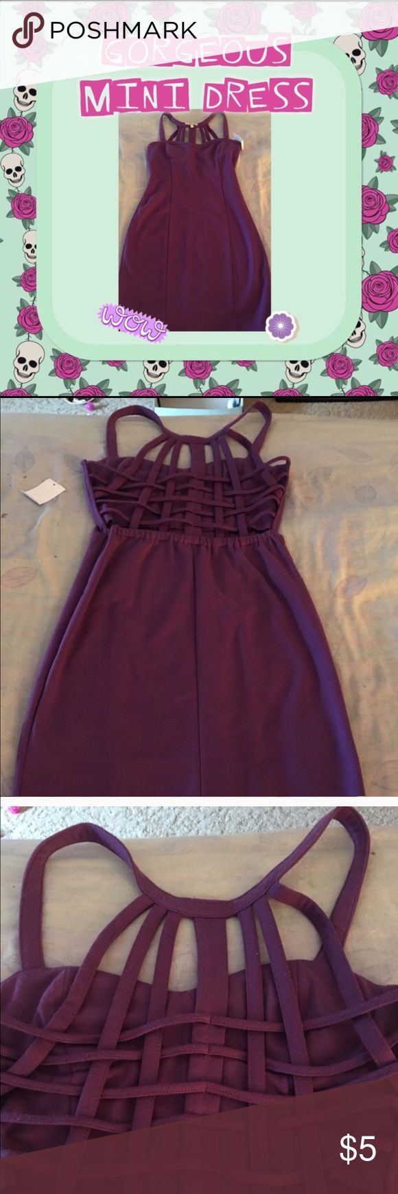 Purple mini dress with caged style back NWT sexy deep purple colored mini dress with sweetheart neckline. Stretchy material 95% polyester 5% spandex back is open caged crisis cross style which makes it very sexy and it's also electric around the bottom back. Brand new never worn. Charlotte Russe Dresses Mini