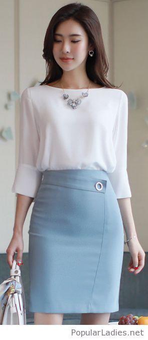 White blouse, light blue skirt and a bag