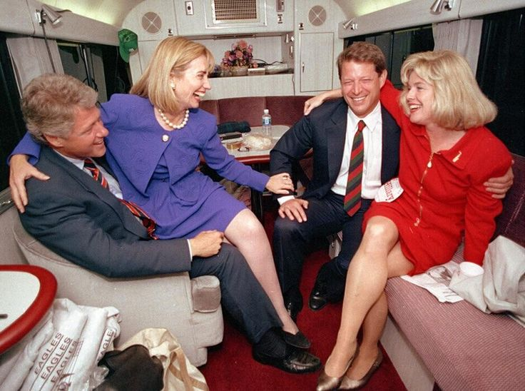 Democratic presidential candidate Bill Clinton and his wife Hillary share a moment with vice presidential candidate Al Gore and his wife Tipper during a brief rest on their bus in Durham N.C. prior to the 1992 presidential elections [940x700]