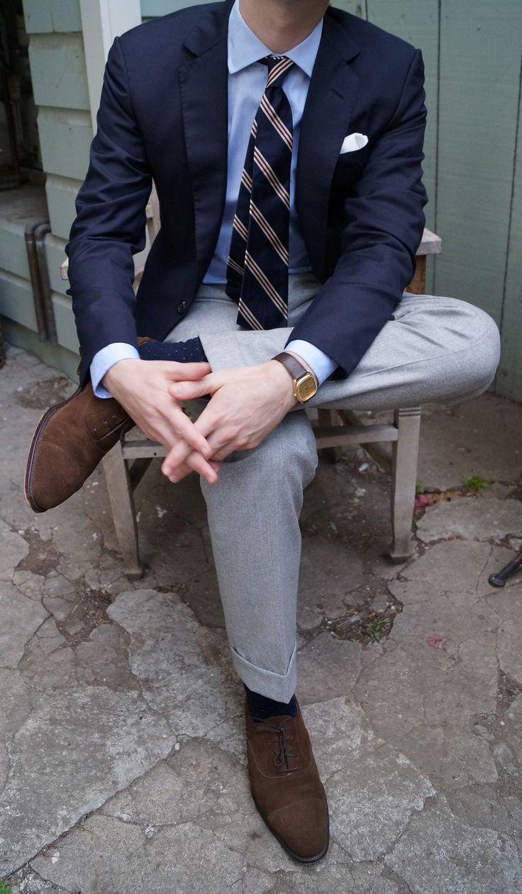 Navy blazer, light grey slacks.