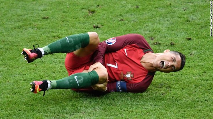 """Cristiano Ronaldo reacts after a tackle by Dimitri Payet during <a href=""""http://www.cnn.com/2016/07/10/football/france-portugal-euro-2016-final/index.html"""" target=""""_blank"""">the Euro 2016 final</a> between Portugal and France on Sunday, July 10. Portugal won despite Ronaldo being forced to leave the game with a knee injury."""
